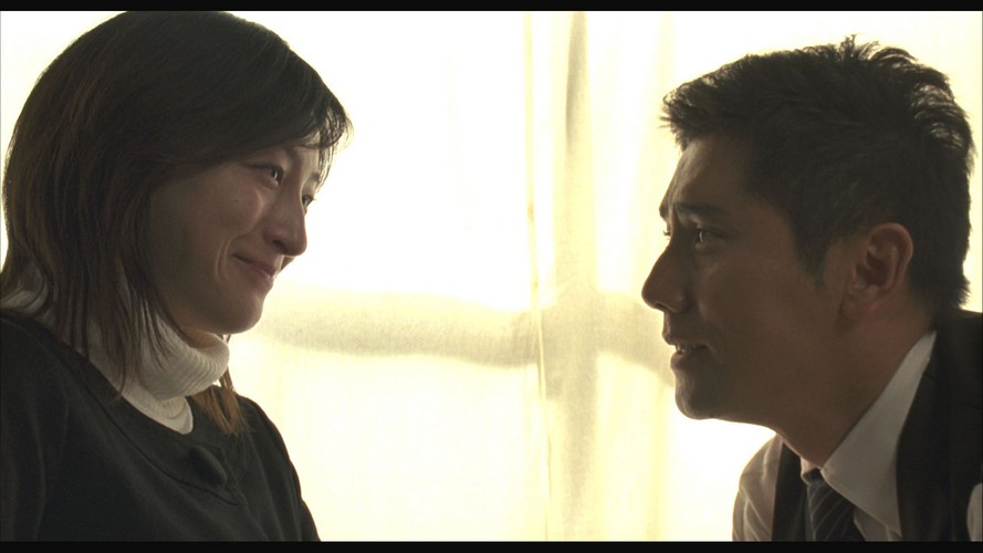 小林美香(広末涼子)と小林大悟(本木雅弘)夫妻