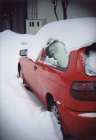 a red car in the snow