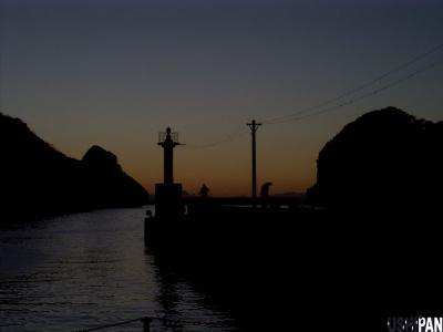 釣り人と夕焼け